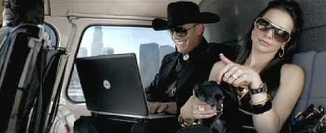 Helicopter passenger uses black Dell Inspiron