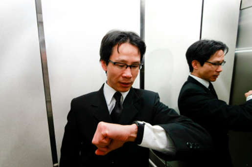 Elevator guy looks at his watch