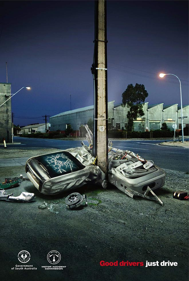 Telephone pole in road safety print advertisement