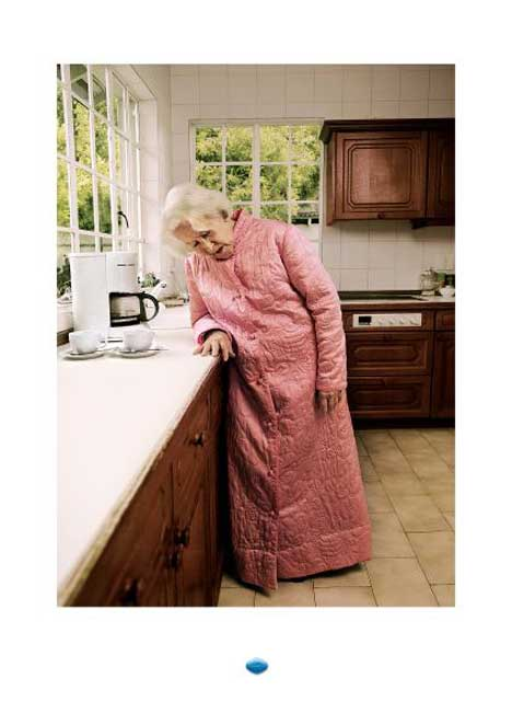 Women falls asleep making coffee in Viagra print ad