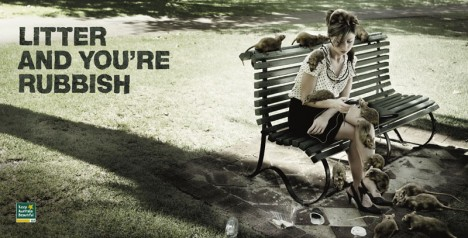 Keep Australia Beautiful woman on park bench with rats