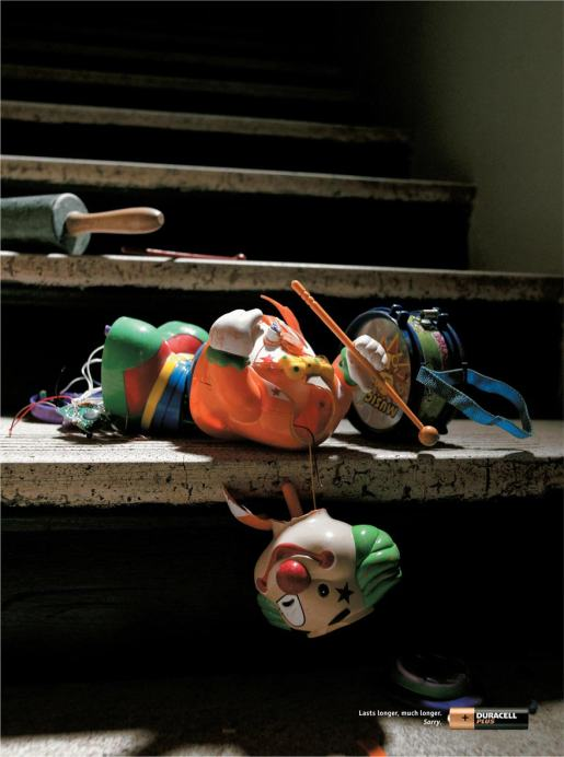 Clown toy lasts longer in Duracell print advertisement