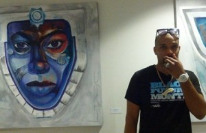 Artist Danilo McCallum with his painting, Mother of Moons