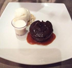 Chocolate and salted caramel fondont with vanilla beans ice cream with white chocolate milk shake