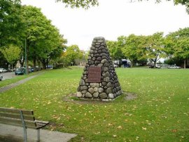 A marker placed at the location of the Marpole Midden. Photo courtesy of Parks Canada