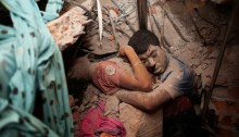 Two victims amid the rubble of the Rana Plaza factory in Dhaka, Bangladesh. | Photo courtesy of Times Asi