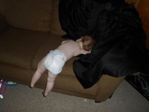 sleeping hanging from couch