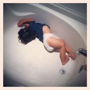 sleeping in an empty bathtub