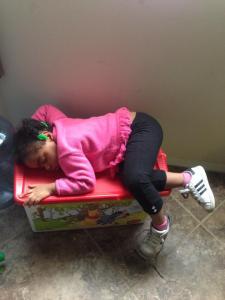 sleeping on diaper bin