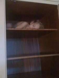 sleeping on top shelf in closet