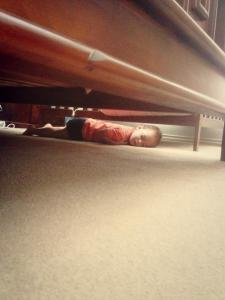sleeping under the bed up to no good