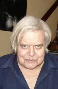 Headshot of H.R. Giger, a white man with white hair