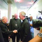 Bishop James Vann Johnston, the new bishop for the Diocese of Kansas City-St. Joseph, greets Msgr. William J. Blacet, pastor of Our Lady of Good Counsel Parish, at a press conference introducing the bishop. Photo by Doug Hesse