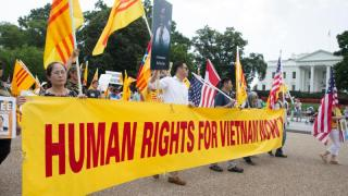 """People protest for human rights and democracy in Vietnam outside the White House in 2015 in Washington. During a May 24 news conference, U.S. Rep. Chris Smith, R-N.J., said that President Barack Obama's decision to lift the arms embargo in Vietnam """"failed to advance long-term U.S. interests."""" (CNS photo/Michael Reynolds, EPA) See VIETNAM-HUMAN-RIGHTS May 26, 2016."""