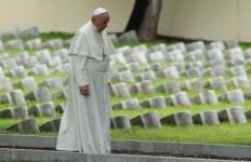Pope Francis walks through the  Austro-Hungarian cemetery for fallen soldiers of World War I in Fogliano di Redipuglia, Italy, in this Sept. 13, 2014, file photo. The pope visited the cemetery in silence. He also plans to maintain silence when he visits the Auschwitz-Birkenau Nazi death camp during his July 27-31 trip to Poland for World Youth Day. (CNS photo/Paul Haring) See VATICAN-LETTER-AUSCHWITZ June 30, 2016.