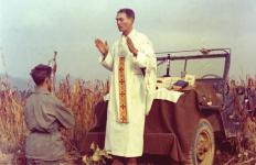 U.S. Army chaplain Father Emil Joseph Kapaun, who died May 23, 1951, in a North Korean prisoner of war camp, is pictured celebrating Mass from the hood of a jeep Oct. 7, 1950, in South Korea. He is a candidate for sainthood.  (CNS photo/courtesy U.S. Army medic Raymond Skeehan) See KAPAUN-CAUSE-STEP-CLOSER June 30, 2016.