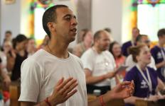 Sean Goug, 26, of England, prays at Sacred  Heart Church in Krakow, Poland, July 28. (CNS photo/Bob Roller) See WYD-MISSIONARIES-MERCY July 28, 2016.