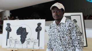 Serge Kiala, a Congolese artist living now in Rio de Janeiro, poses for a photo Sept. 14. Kiala is one of the four refugees taken in by Caritas, charitable agency of the Archdiocese of Rio de Janeiro, who are showing their work at the Museu do Amanha (Museum of Tomorrow). (CNS photo/Lise Alves) See BRAZIL-REFUGEES-CARITAS-ART Sept. 22, 2016.