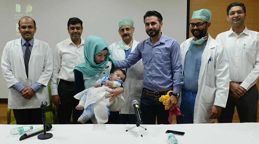 Iraqi Baby With Eight Limbs Have Them Removed - Money Sharma/AFP