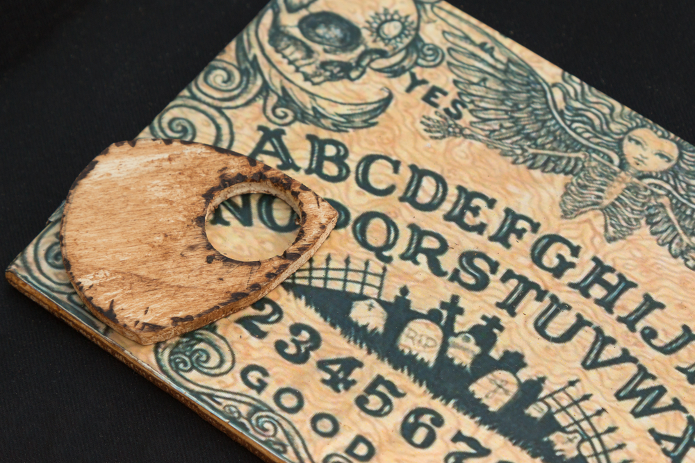 An ouija board is said to help mediums communicate with the dead