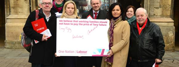 Lincoln Labour Parliamentary candidate Lucy Rigby (centre, front) and Don Valley MP Caroline Flint campaigned on the High Street against the controversial 'strivers tax'. Photo: Steve Smailes for The Lincolnite