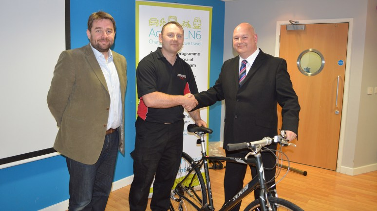 Councillor Richard Davies and Paul Hutson from Arrow Cycles presenting Tom Whittock with his brand new £400 Specialized Hybrid bike. Photo: Hayley Cook/ LCC