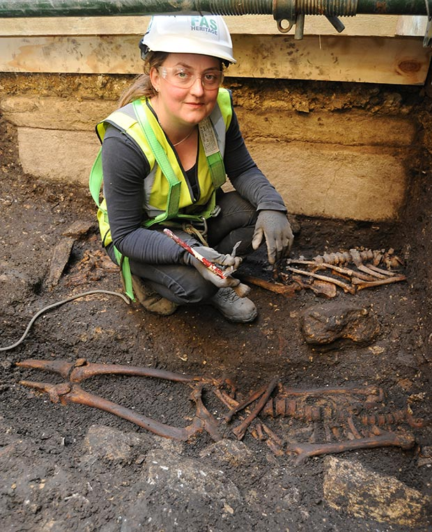 Archaeologist Cecily Spall from FAS Heritage uncovers one of the skeletons.