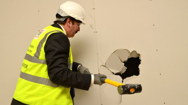 City of Lincoln Council Chief Executive, Andrew Taylor hammers a wall. Photo: Steve Smailes for The Lincolnite