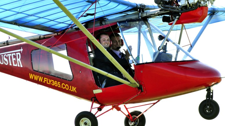 A top prize for pitches include a flight over the winner's home. EMP's network founder Michael Overton tests one of Fly365 planes with Mark Yeates. Photo: K Middleton