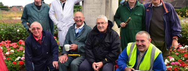 Civic pride: Volunteers helped repaint the Boultham war memorial railings. Back row (L-R): Ian Durrant, Ron Everitt, Eddie Fisher and Bill Lee; front row (L-R): John Fisher, John Evison, Rodger Twigg and Steve Clark. Photo: Steve Smailes for The Lincolnite