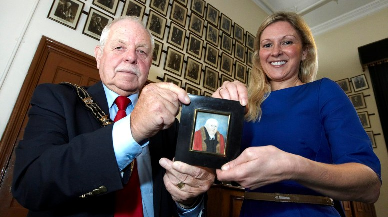 Lisa Barber (pictured), daughter of Roy Fines who lived in Lincoln before his death in 2012, traveled from Winchester to present  a miniature watercolour picture of Thomas Jepson - Mayor of Lincoln in 1790 - to the current mayor Patrick Joseph Vaughan (pictured) at the Guildhall in Lincoln.