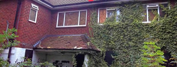 A typical empty property in North Kesteven, overgrown, vandalised, boarded up and neglected. Photo: NKDC