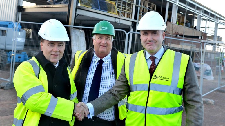 Steve Hampson, Managing Director, Harlaxton Estates Ltd, David Balfe, Managing Director, T Balfe Construction and Paul Tutin, Chairman and Managing Partner, Streets Chartered Accountants on site outside Streets' new office during its build pre Christmas 2013.
