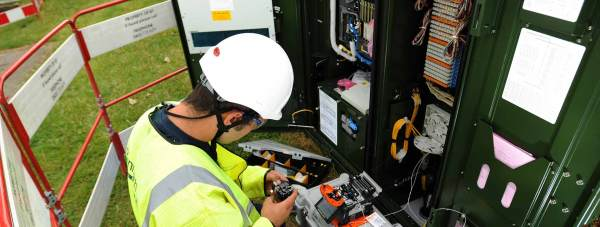 An engineer upgrading an exchange box for superfast broadband. Photo: BT