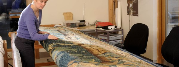 Heritage Skills Centre conservator, Sophie Minnis, threads new life into ancient tapestries. Photo: LCC