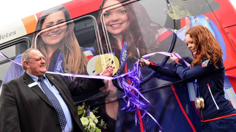 Jade cut the ribbon to unveil her new Lincoln Stagecoach bus. Photo: Steve Smailes for The Lincolnite
