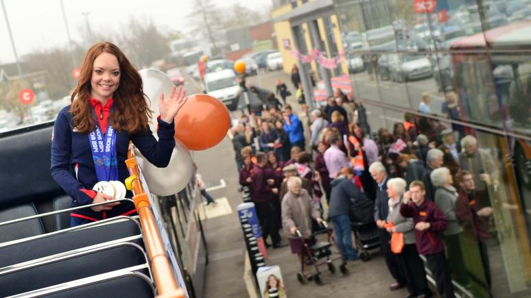 Jade waved to crowds aboard her 'welcome home' tour bus. Photo: Steve Smailes for The Lincolnite