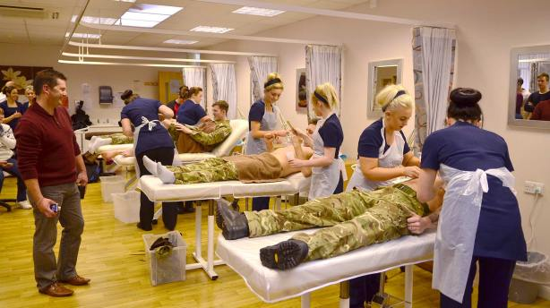 Beauty Therapy Students from Lincoln College wax Lincoln RAF personnel for charity. Photo: Steve Smailes for The Lincolnite