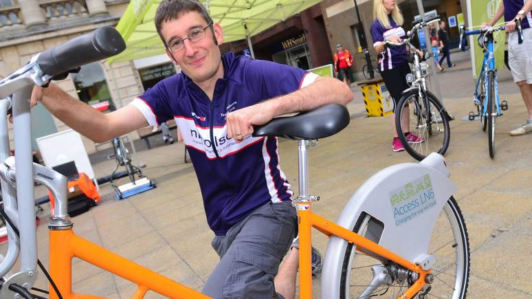 Nicholsons Chartered Accountants' Simon Hall and his hirebike for the 100 mile ride. Photo: Steve Smailes for The Lincolnite