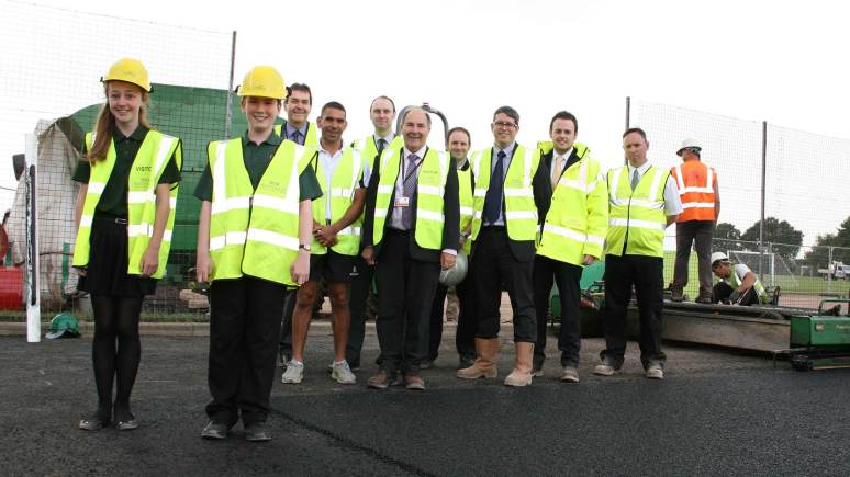 NK School students Holly Blackburn and Oliver Pallister; headteacher Martin Connor and head of PE Gary Walters; with NKDC's Cultural Services Manager Mike Lock and Senior Buildings Surveyor Scott Masterman; Leisure in the Community's contract manager Matt Stothard; and, from contractors Robert Woodhead Ltd, business development director Glenn Slater, project manager Mark Maisey, and site manager Nick Smith as the base layer for the new 3G pitch nears completion. Photo: NKDC