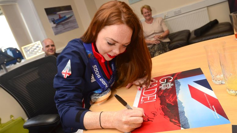 Jade was greeted by staff at Your Print Partner in Lincoln. She also signed posters designed by members of staff. Photo: Steve Smailes for The Lincolnite