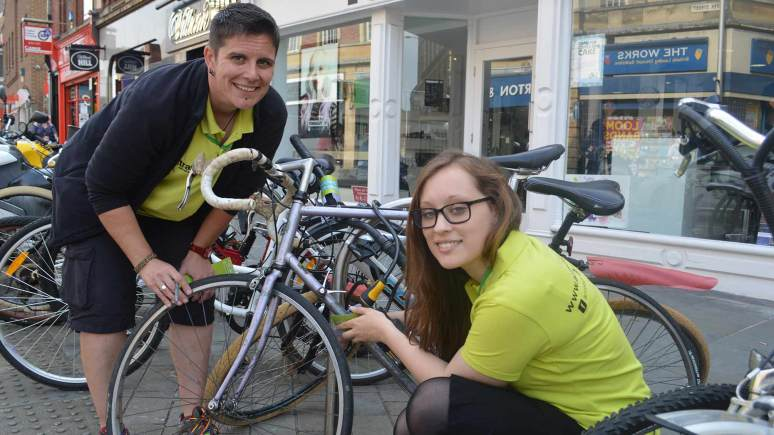 Lou Christy and Paige Hancy from the Access LN6 team grade bikes in Lincoln city centre to help prevent bike theft.