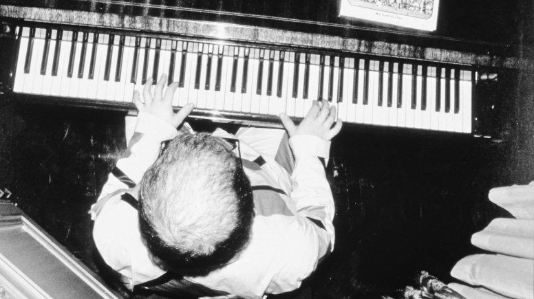 Elton John revealing, in New York, his hair-transplant. Photo: Mike Maloney