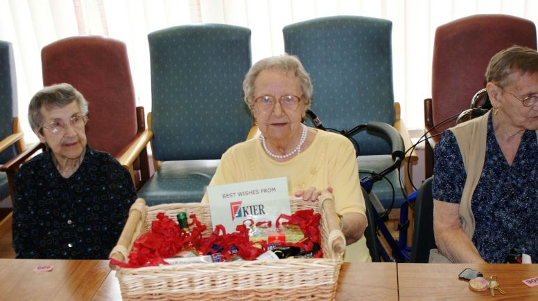 Tenants Lydia Marshall, Joan White and Vera Ashton with their gifts from developers Kier.