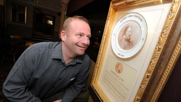 Matthew Gillet looking at a Tennyson plate in the Woodcocks pub (which Matthew manages).