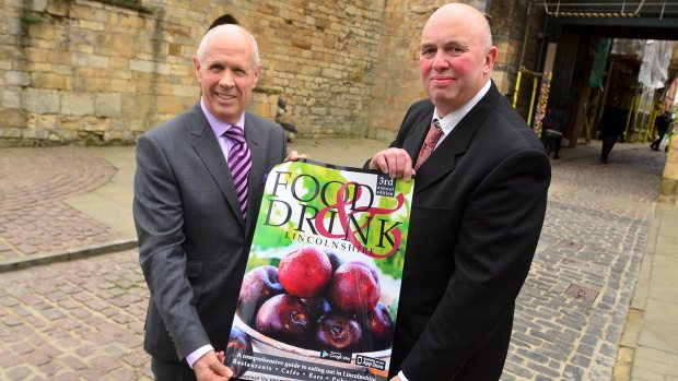 Robin Fry and Councillor Colin Davie revealing the new guide. Photo: Steve Smailes for The Lincolnite