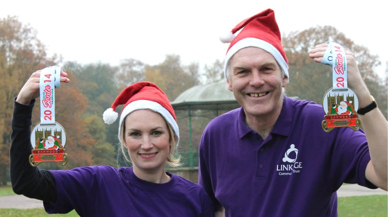 Runners Louise Cotton and Tony Barker from Linkage with the new medal at Boultham Park.