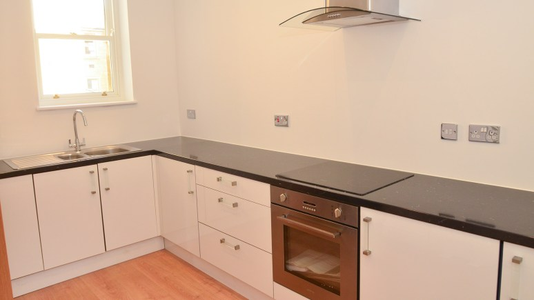 A kitchen within one of the new apartments in St Johns Village: Photos by Steve Smailes