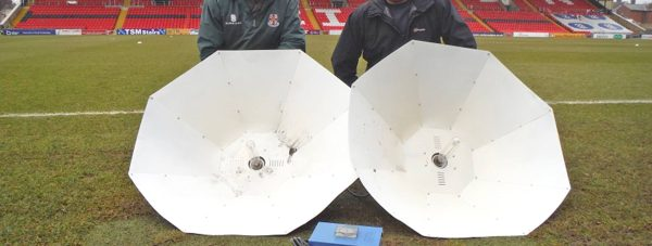 The heat lamps were donated to Lincoln City FC to help with pitch grass growth. Pictured: Lincoln City FC Head Groundsman Phil Kime (left) and his assistant Paul Ash.