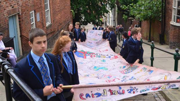 Pupils from Lincoln Castle Academy delivering the scroll to Lincoln Castle. Photo: Steve Smailes for The Lincolnite